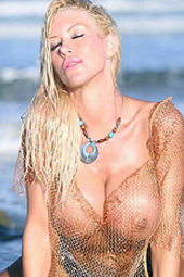 Tania Amazon Posing In Fishnet Top